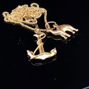 AN 18CT GOLD ANCHOR PENDANT AND CAMEL PENDANT SUSPENDED ON AN 18CT GOLD CURB CHAIN