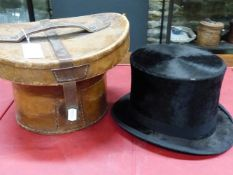 A WINE RED VELVET LINED LEATHER CASED KERR AND MCKENZIE TOP HAT WITH BLACK SILK PILE, THE INTERIOR
