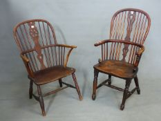 A YEW AND OAK WINDSOR CHAIR, THE SADDLE SEAT ON TURNED CYLINDRICAL FRONT LEGS ON SPINDLE FEET