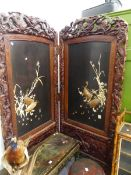 A LARGE LATE VICTORIAN ORIENTAL CARVED TWO FOLD SCREEN WITH IVORY AND LACQUER PANELS. EACH PANEL