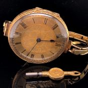 AN 18ct GOLD SWISS FOB WATCH REMODELLED AS A WRIST WATCH, CASE MARKED WITH SWISS HELVETIA