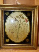 A PAIR OF LATE GEORGIAN OVAL SILKWORK PANELS OF FLOWERS, 21 x 15cms, TOGETHER WITH ANOTHER MOUNTED