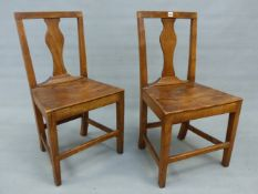 A PAIR OF GEORGIAN COUNTRY OAK SIDE CHAIRS WITH BALUSTER SPLATS, SOLID SEATS AND TAPERING SQUARE