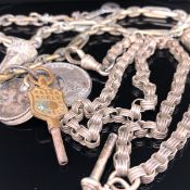 AN ANTIQUE SILVER WATCH CHAIN COMPLETE WITH T-BAR AND PART FOB. LENGTH 38.5cms, WEIGHT 29.3grms,