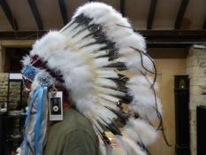 AN OKLAHOMA INDIAN CRAFTS Co. REPLICA WAR BONNET WORKED IN BEADS, FEATHERS AND FUR
