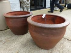 PAIR OF LARGE STONEWARE GARDEN POTS. D. 54 x H. 40cms, TOGETHER WITH AN ANTIQUE CARVED STONE PLANTER