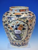 AN 18th C. JAPANESE IMARI OVOID JAR PAINTED WITH THREE RESERVES OF CHRYSANTHEMUMS ON A BAMBOO AND