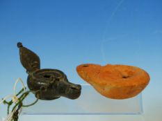 A ROMAN BRONZE OIL LAMP WITH HANGING CHAIN AND LEAF SHAPED HANDLE. W 11.5cms. TOGETHER WITH A