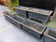 A HARLEQUIN SET OF SIX ANTIQUE IRON PLANTERS, THE RECTANGULAR RIMS OVER FLUTED BANDS AND CENTRAL