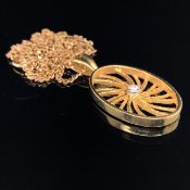AN 18ct GOLD AND DIAMOND OPEN WORK PENDANT, SIGNED T.O.D'S SUSPENDED ON A 9ct GOLD CURB CHAIN. CHAIN