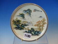 A CHINESE DISH PAINTED WITH A FIGURE CROSSING A BRIDGE BETWEEN MOUNTAINOUS ISLANDS, TWO CHARACTER