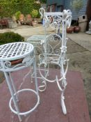 A PAIR OF WROUGHT IRON PATIO CHAIRS, THREE PLANT STANDS AND A LOVE SEAT (6).
