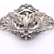 A CONTINENTAL SILVER BELT BUCKLE WITH A HINGED NICKEL CLASP. CHASED AND ENGRAVED WITH A SPREAD
