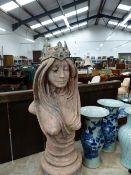 AN ART NOUVEAU STYLE TERRACOTTA COLOURED COMPOSTION BUST OF A LADY ON PLINTH BASE, HER CROWN SET WIT