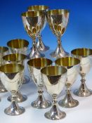 A SET OF TWELVE HALLMARKED SILVER GOBLETS WITH ENGRAVED SWAG DECORATION, DATED 1972-1973 LONDON.