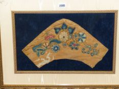 AN 18th C. STUMPWORK COLLAR WORKED WITH FLOWERS AND MOUNTED ON BLUE VELVET WITHIN A GILT GESSO