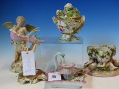 A MEISSSEN FLORAL ENCRUSTED CHAMBERSTICK, CUP AND SAUCER TOGETHER WITH A GERMAN PORCELAIN CUPID, A
