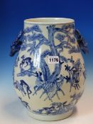 A CHINESE BLUE AND WHITE VASE PAINTED WITH DEER BELOW PINE TREES AND WITH STAGS HEAD HANDLES, SIX