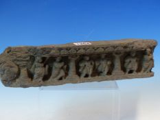 A GANDHARAN GREY SCHIST FRIEZE FRAGMENT CARVED WITH SIX FIGURES STANDING AMONGST COLUMNS. W 32.