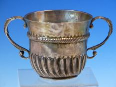 A RARE EARLY TWO HANDLED SILVER PORRINGER, HALLMARKS FOR LONDON 1700 FOR WILLIAM ANDREWS. ENGRAVED