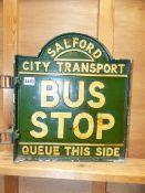 AN ALUMINIUM SALFORD CITY TRANSPORT BUS STOP SIGN.