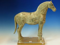 AN EARLY CHINESE POTTERY FIGURE OF A HORSE. POSSIBLY TANG DYNASTY. H. 38cm.
