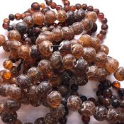 A CONTINUOUS ROW OF ANTIQUE IRREGULAR AMBER BEADS, POSSIBLY CHINESE. APPROX SIZE OF LARGEST BEAD