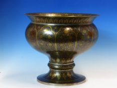A BENARES BRASS STANDING BOWL WORKED WITH VINES, FLOWERS AND LEAVES, THE BRASS DETAILED IN SILVER ON