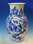 A CHINESE BLUE AND WHITE BALUSTER VASE PAINTED WITH RIDERS TRAVELLING THE SHORELINE OF A ROCKY