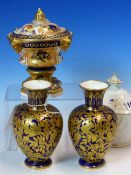 A PAIR OF CROWN DERBY GILT ON BLUE OVOID VASES. H 15cms. FOUR CROWN DERBY IMARI COFFEE CANS AND