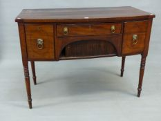 A 19th C. MAHOGANY BOW FRONT SIDEBOARD, THE CENTRAL DRAWER OVER A TAMBOUR AND FLANKED BY A