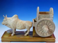 AN EARLY CHINESE POTTERY FIGURAL GROUP OF A BULLOCK AND CART. POSSIBLY TANG DYNASTY. H. 30cm.