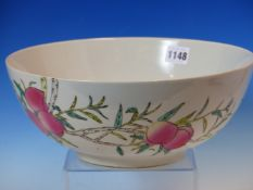 A CHINESE BOWL PAINTED WITH PEACHES AND WITH TWO IRON RED BATS. Dia. 28cms.
