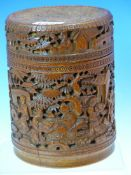 A CHINESE CARVED BAMBOO CYLINDRICAL BOX AND COVER DEPICTING WORKMEN AND TRAVELLERS IN A LEAFY