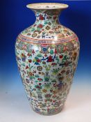 A CHINESE FAMILLE ROSE OVOID VASE DECORATED WITH FLOWERS AND SCATTERED PRECIOUS OBJECTS, SEAL MARK