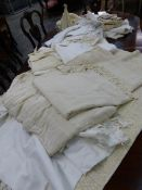 A LARGE COLLECTION OF ANTIQUE AND LATER WHITE WORK TABLE LINEN AND COVERS INCLUDING NAPKINS,
