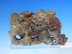 A WELL CARVED CHINESE SOAPSTONE FIGURE OF A FOO LION WITH PUPS. W. 18cm