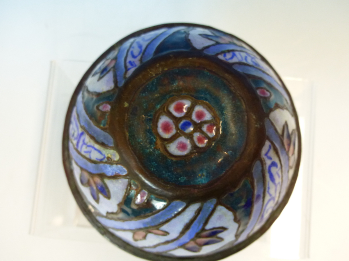 Lot 2368 - AN EASTERN CHAMPLEVE ENAMELLED COPPER BOWL, THE EXTERIOR WITH SPIRALS OF BLUE SCRIPT ALTERNATING WIT