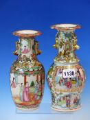 TWO 19th C. CANTON VASES VARIOUSLY PAINTED WITH FIGURE AND GARDEN FLOWERS BELOW GILT BUDDHIST LION