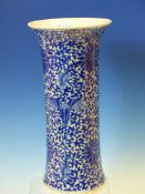 A CHINESE BLUE AND WHITE SLEEVE VASE WITH FLARED RIM, PAINTED WITH SCROLLING LOTUS. H 30cms.