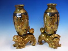 A PAIR OF SATSUMA POTTERY OVOID VASES PAINTED WITH KWANNON AND LUOHANS ON A BLACK GROUND, THE