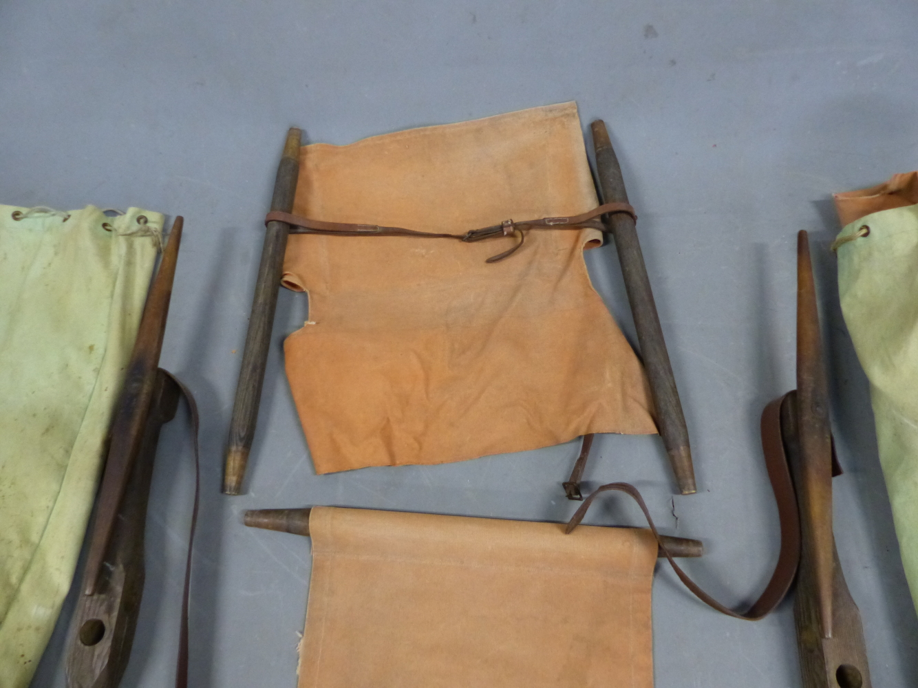 Lot 2187 - A PAIR OF VINTAGE CAMPAIGN SAFARI CHAIRS, COMPLETE IN CANVAS CARRY BAGS (2).