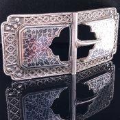 A PERSIAN NIELLO FINE SILVER BELT BUCKLE, LENGTH 9cms X 4.2cms, WEIGHT 73.1grms.