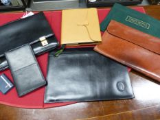 A DUNHILL BLACK LEATHER BRIEF CASE, A CARRIER BLACK LEATHER NOTE AND CARD CASE, A SMYTHSON TAN