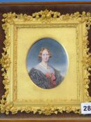 A VICTORIAN OVAL PORTRAIT MINIATURE OF A LADY WEARING A BLACK DRESS TIED WITH A RED RIBBON, THE