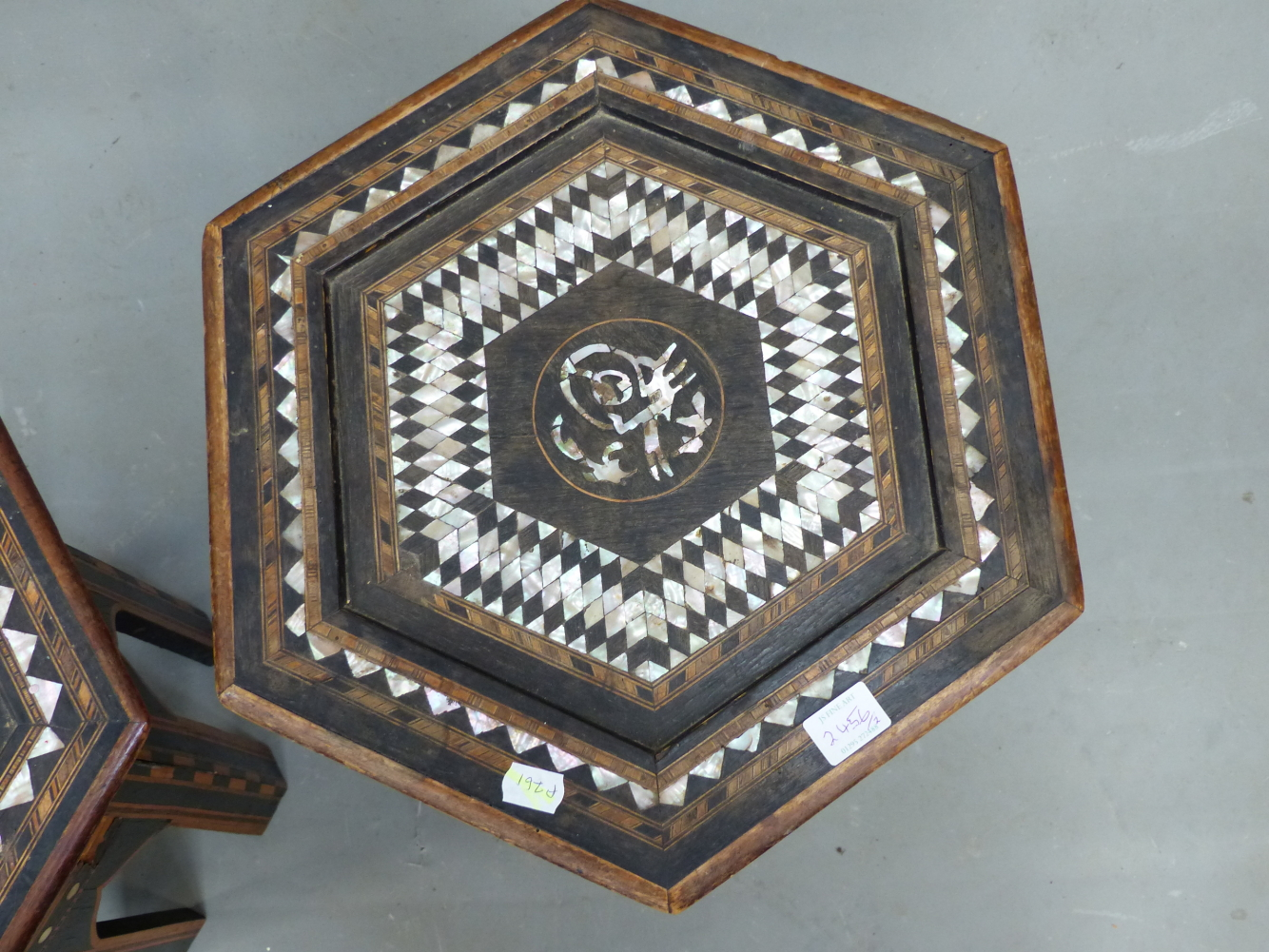 Lot 2456 - AN ISLAMIC HEXAGONAL TABLE, THE BANDS OF GEOMETRIC INLAY TO THE TOP ENCLOSING A ROUNDEL OF EBONY