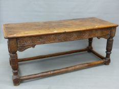 A 17th.C. AND LATER OAK REFECTORY TABLE WITH THREE PLANK TOP OVER CARVED FRIEZE, TURNED AND CARVED L