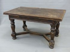 A 17th.C.STYLE OAK DRAW LEAF REFECTORY DINING TABLE ON TURNED SUPPORTS WITH CROSS STRETCHER. L.