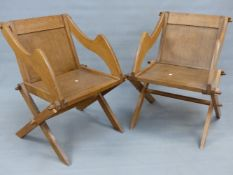A PAIR OF ENGLISH OAK GLASTONBURY ARMCHAIRS WITH MORTICE PEG JOINTS. 70cm (W).