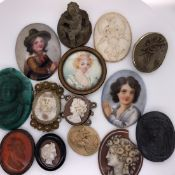 A GROUP OF ANTIQUE AND LATER DEEP RELIEF CARVED LAVA SHELL AND AGATE CAMEOS, TWO PORCELAIN HAND